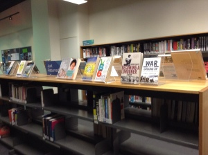 Books just fly off these shelves! Titles that have just been returned (or that need a bit of circulation and are lost on the shelves) get put here so that they are more visible to the general public. Love this promotion of great (or just popular) literature!