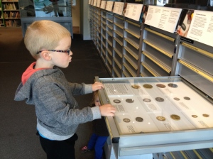 Will is mightily impressed with the old coins.